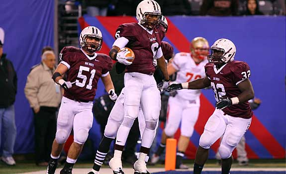 Elijah Shumate celebrates with some teammates after scoring a touchdown for Don Bosco Prep.