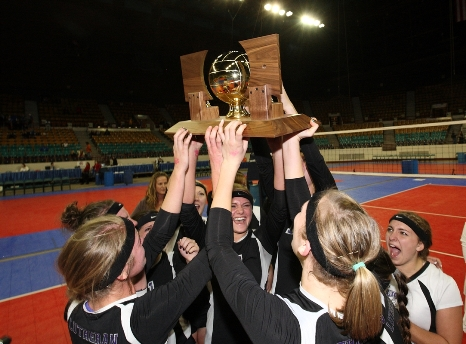Lutheran celebrates after winning its second consecutive Class 2A state title. The Lions beat Simla 3-1 in a matchup of unbeaten teams Saturday at the Denver Coliseum.