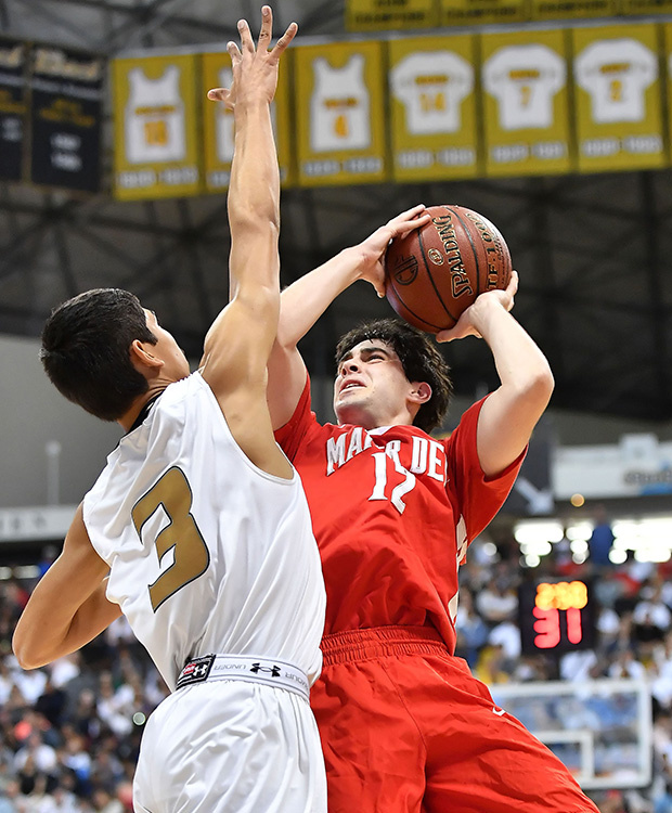 Mater Dei guard Spencer Freedman takes a jump shot in front of Bishop Montgomery's Josh Vazquez.