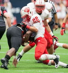 Katy defensive back Colton Asheim (22) with another big hit.
