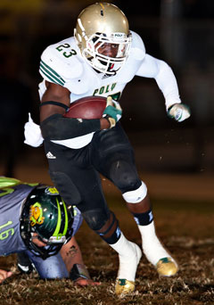 Gerard Wicks runs hard for Poly, and onFriday he was the workhorse.