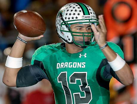 Carroll quarterback Kenny Hill threw for 112 yards and had 130 yards rushing in Saturday night's playoff victory over Trinity.