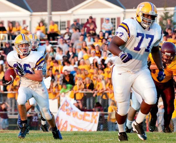 Seantrel Henderson of Cretin-Derham Hall (right) is one of the most imposing college football recruits in recent years.