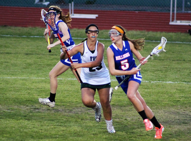 Mariann Trecki (on defense) has gone all-in with lacrosse and results continue to appear.