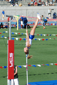Taylore Jacques goes straight up for her winning vault at the state track and field championships.