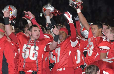 Mentor players celebrate Saturday night following their triple-overtime playoff victory over defending state champion St. Ignatius.