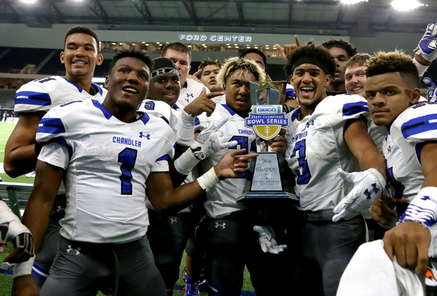 Chandler (Ariz.) players proudly display the Geico State Champions Bowl Series trophy following their victory over Valdosta (Ga.) at The Star in Texas.