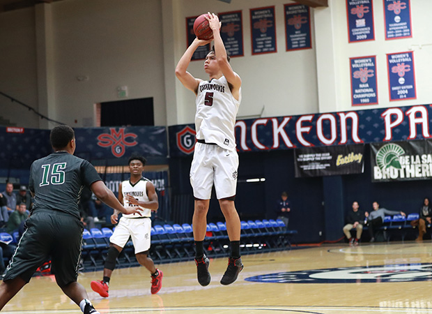 Woodcreek forward Chris Cagle scores two of his game-high 28 points.