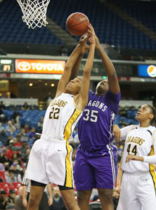 Bishop O'Dowd's Oderah Chidom and Sacramento's Ayanna Edwards battle for a rebound.