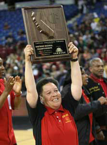 Coach Cheryl Draper holds up Berkeley's 10th NorCal title.