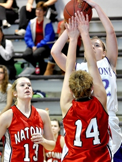 Karlie Steinle of Wilson High shoots asDanica Casey of Natoma High (left) watches.