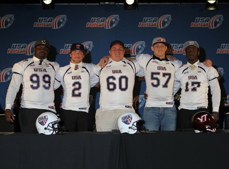 Tevin Montgomery (99), Shane Cockerille (2), Austin Droogsma (60), Wyatt Teller (57) and Lance Virgile (17) pose during the 2013 USA Football Signing Day Breakfast at The Renaissance Hotel Austin on Wednesday.