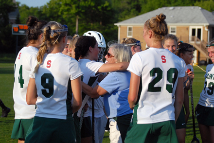 Kathy Jenkins (center) is congratulated following her 600th  win.