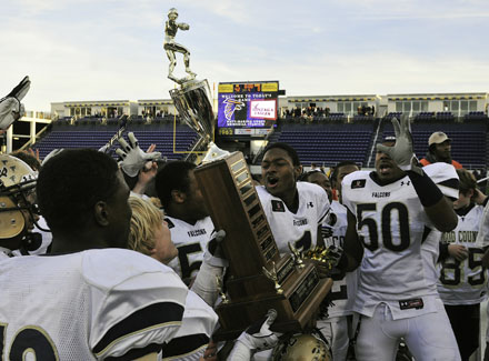 Good Counsel players celebrate their school's first-ever undefeated season.
