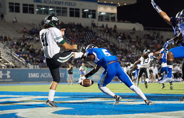 Ryker Brazerol of IMG blocks a Central punt attempt in the end zone.