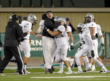 """Granite Bay coach Ernie Cooper with Taft Partridge III, proving his own theory that """"all coaches are a little bit crazy."""""""