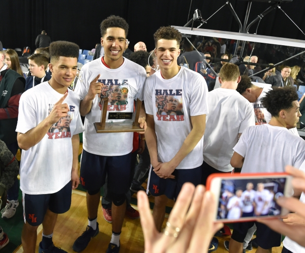 Porter brothers (from left) Coban, Jontay and Michael smile for mom Lisa after winning the state title Saturday.