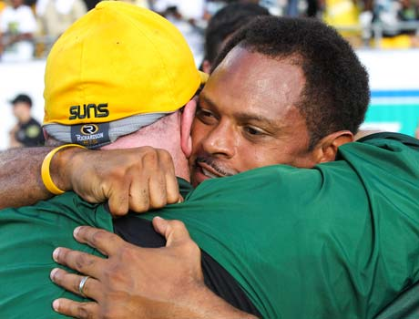University head coach Roger Harriott receives a congratulatory hug following his team's victory in the Florida 3A state championship game on Saturday.